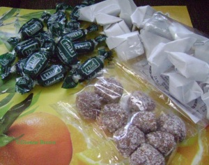 A tiny stash of Jamaican-made sweets consisting of sweet and tangy tamarind balls, icy mint (i.e. peppermint candy and busta, a firm yet chewy coconut confection.